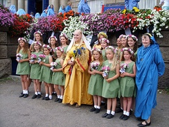 Children standing with The Lady of Cornwall in a neopagan ceremony in England