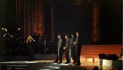 "Carey performing ""One Sweet Day"" alongside Boyz II Men, during a taping at Madison Square Garden in October 1995"