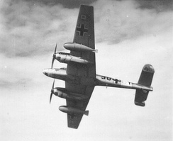 Bf 110 with twin 900 litre drop tanks with vertical fins, from 9.Staffel/ZG 26, on a Regia Aeronautica photo