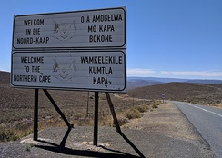 Sign along R354 welcoming motorists into the Northern Cape from the Western Cape. The sign is in Afrikaans (top left), English (bottom left), Tswana (top right), and Xhosa (bottom right)