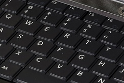 Keyboards on laptops usually have a shorter travel distance and a reduced set of keys.