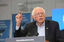 Senator Bernie Sanders, a self-described democratic socialist, whose presidential campaigns in 2016 and 2020 has attracted significant support from youth and working class groups while realigning the Democratic Party further to the left[250]
