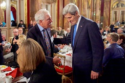 Turner and U.S. Secretary of State John Kerry in December 2015