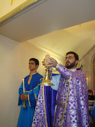 An Armenian priest (at the right)