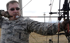 Chief Master Sgt. Kevin Peterson demonstrates safe archery techniques while aiming an arrow at a target on the 28th Force Support Squadron trap and skeet range at Ellsworth Air Force Base, S.D., October 11, 2012.