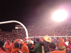 Utah Utes fans rush the field and carry the goalpost after defeating rival BYU in November 2004, completing a perfect regular season, and becoming the first BCS Buster by clinching a spot in the 2005 Fiesta Bowl (hence the sombrero).