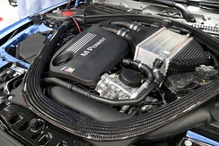 S55 engine in a 2014 BMW M3; the cuboid-shaped metal component is the air-to-liquid charge air cooler.