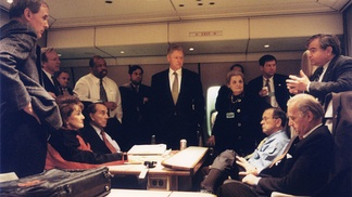Lieberman (second from the left) and Senate colleagues with President Bill Clinton and his national security team on Air Force One to Bosnia in 1997