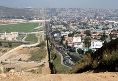 Border fence between Tijuana (right) and San Diego's border patrol offices (left)
