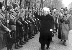 Haj Amin al-Husseini gives the Nazi salute while reviewing a unit of Bosnian SS volunteers in 1943 with Waffen-SS General Sauberzweig.