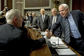 "Hearing regarding ""Don't Ask, Don't Tell,"" U.S. Secretary of Defense Robert M. Gates greets Ranking member, John McCain. December 2, 2010."