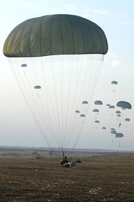 U.S. Army paratroopers with the 82nd Airborne Division parachute from a C-130 Hercules aircraft during Operation Toy Drop 2007 at Pope Air Force Base