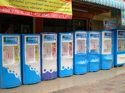 Drinking water vending machines in Thailand. One litre of potable water is sold (into the customer's own bottle) for 1 baht.