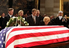 Ford's casket lies in state at the United States Capitol as his widow, Betty, kneels in prayer
