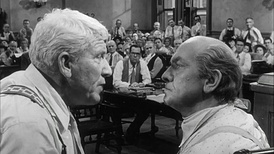 Henry Drummond (Tracy, left) and Matthew Harrison Brady (March), right) in Inherit the Wind.  Previously, March had taken the role in The Desperate Hours originally offered to Tracy.  Both men had also played Dr. Jekyll/Mr. Hyde.