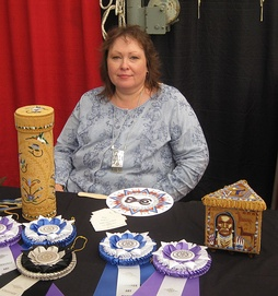 Jackie Larson Bread (enrolled Blackfeet Tribe of Montana) with her award-winning beadwork