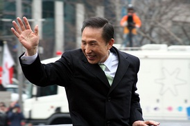 Lee Myung-Bak waves to the crowd from his motorcade after he is inaugurated as Korea's new President in February 2008.