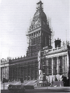 B&W photograph of a scaffolding-covered Town Hall undergoing cleaning