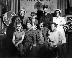 The cast of M*A*S*H from Season 6, 1977 (clockwise from left): William Christopher, Gary Burghoff, David Ogden Stiers, Jamie Farr, Mike Farrell, Alan Alda, Harry Morgan, Loretta Swit.