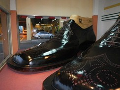 World's largest pair of shoes, Riverbank Center, Philippines—5.29 metres (17.4 ft) long and 2.37 metres (7 ft 9 in) wide, equivalent to a French shoe size of 75.