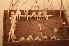 Wooden qasgiruaq (qasgiq model) with walrus ivory dolls. Ethnological Museum of Berlin.