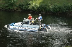 A Land Rover with inflatable floats to create a vehicle that will swim much like an improvised raft
