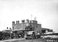 RAF Molesworth Control Tower, taken on 28 September 1944, with wing staff waiting on the return of the 303d Bombardment Group from a mission. Note Lockheed/Vega B-17G-60-VE Fortress 44-8328 359th Bombardment Squadron (Code BN) parked next to tower