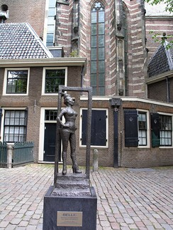 "Statue to honor the sex workers of the world. Installed March 2007 in Amsterdam, Oudekerksplein, in front of the Oude Kerk, in Amsterdam's red-light district De Wallen. Title is Belle, inscription says ""Respect sex workers all over the world."""