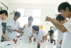 Vietnamese science students making an experiment in their university lab.