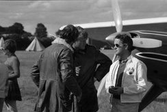 Richard Bach, author of Jonathan Livingston Seagull, and Lynn Garrison with Helio Courier G-ARMU used for Von Richthofen and Brown, 1970