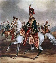 An officer of the British 11th Hussars (PAO) in the full dress of 1856, including dolman, pelisse, busby and sabretache