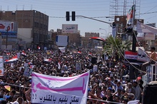 Tens of thousands of protesters marching to Sana'a University, joined for the first time by opposition parties, during the 2011–2012 Yemeni revolution