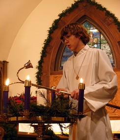 Advent wreath, lighting the candle