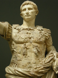 The central breastplate relief on the statue of Augustus of Prima Porta shows the return of the Aquila (Roman eagle standard) lost to the Parthians.