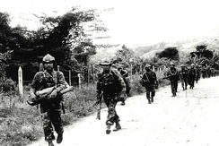 Contra rebels marching through Jinotega in 1985