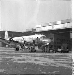 A Pan Am Douglas DC-4 seen parked in front of a hangar at Berlin Tempelhof in January 1954.