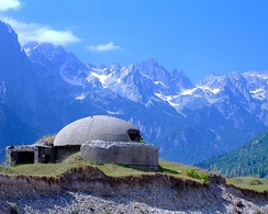 An old communist bunker overlooking the peaks of Valbona Valley. By 1983 approximately 173,371 concrete bunkers were scattered throughout the country.[86]