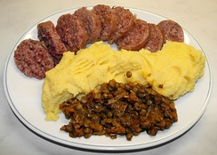 """Cotechino Modena"", as served with polenta and lentils."