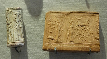 Mesopotamian limestone cylinder seal and the impression made by it—worship of Shamash