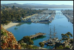 View of Dana Point Harbor with the ship Pilgrim berthed at the Ocean Institute in the foreground