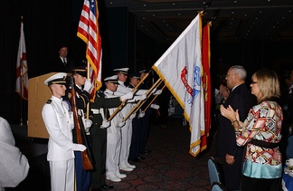 Company E-16 performs a Color Guard for Colin Powell