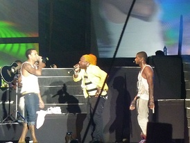Brown with Usher and Elephant Man at the Reggae Sumfest in 2010