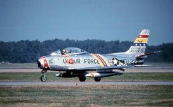 North American F-86F-35-NA Sabre, AF Ser. No. 52-5222 of the 72d Fighter-Bomber Squadron in 1955. The aircraft was painted in the 21st FBW Wing Commander's motif, with blue, yellow and red striping. In 2004, Canadair Sabre N86FS was painted to represent 52-5222, but it crashed in 2006.
