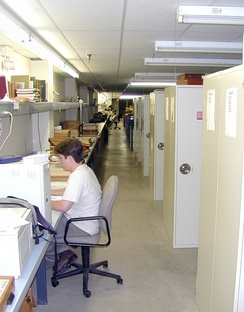 A large herbarium may have hundreds of cases filled with specimens.