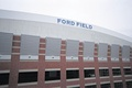 Ford Field allows natural light to penetrate through gray translucent roof panels.
