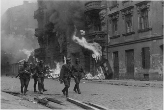NARA copy #11, IPN copy #13An assault squadWaffen SS troops at Nowolipie Street with Nowolipie 50 A, 52, 54 and 56 in the back.
