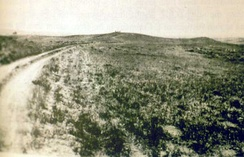 Photo taken in 1894 by H.R. Locke on Battle Ridge looking toward Last Stand Hill (top center). To the right of Custer Hill is Wooden Leg Hill, named for a surviving warrior. He described the death of a Sioux sharpshooter killed after being seen too often by the enemy.[228][229]