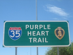 Sign on Interstate 35 designating the Purple Heart Trail.