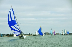 Boats using spinnakers during a regatta in Lorient (France).