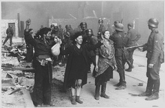 Stroop Report photograph: captured insurgents from the Warsaw Ghetto Uprising, May 1943; the woman on the right is Hasia Szylgold-Szpiro.[307]